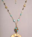 Colgante con pieza africana de bronce con bola tibetana